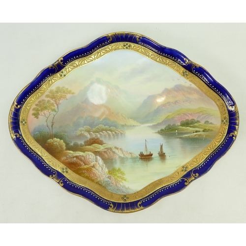41 - Early 20th Century Plaque: Jeweled & gilt hand decorated pottery plaque of Killarney. Signed H. Harr...