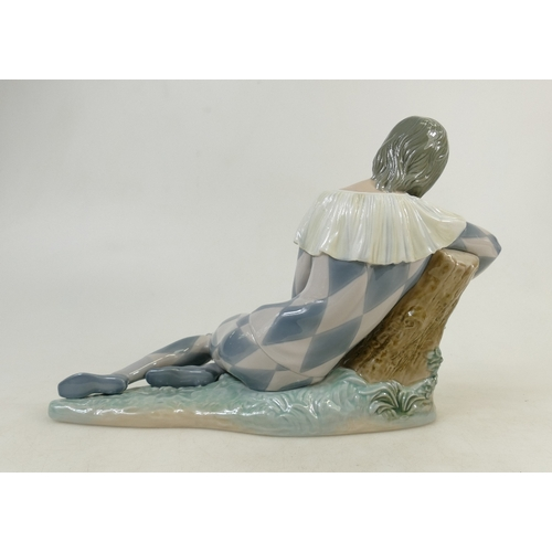 8 - Lladro large figure titled 'Harlequin with Rose': Lladro Harlequin figure height 26cm and length 41c...