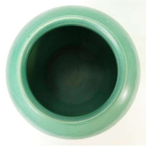 34 - Susie Cooper incised reeded vase: Susie Cooper vase, marked Susie Cooper ref 558 and is 23.5cm high....