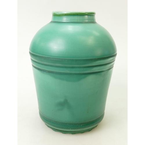 33 - Susie Cooper ribbed vase: Ribbed Susie Cooper vase is marked Susie Cooper ref 277 and is 21.5cm high...