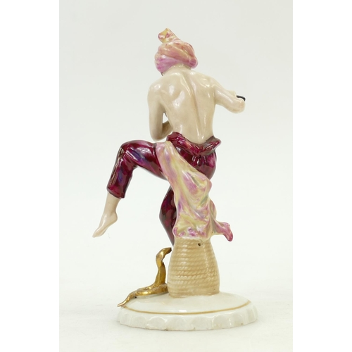 38 - Sitzendorf porcelain figure of a snake charmer: Figure playing the flute, c1930s, height 16cm....