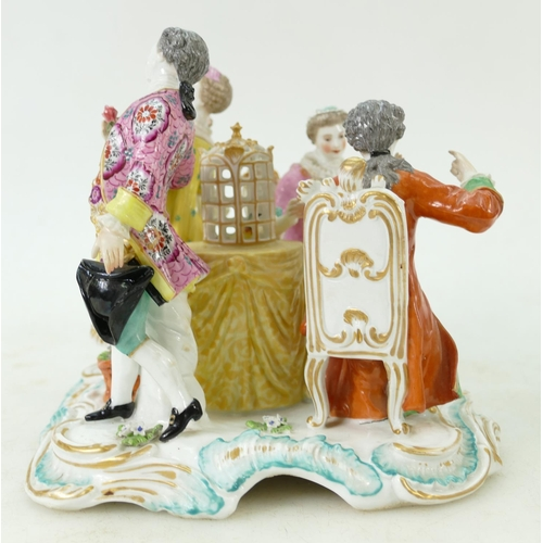 56 - 19th Century German / Continental Figure Group: Large square table group of four gentry figures gath...
