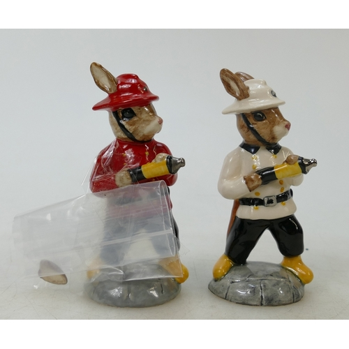 16 - Two Royal Doulton Bunnykins Fireman DB183: Two Fireman figures in different colourways (one white an...