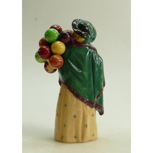 44 - Royal Doulton figure The Balloon Seller HN583: Factory paint issue to back of balloons...