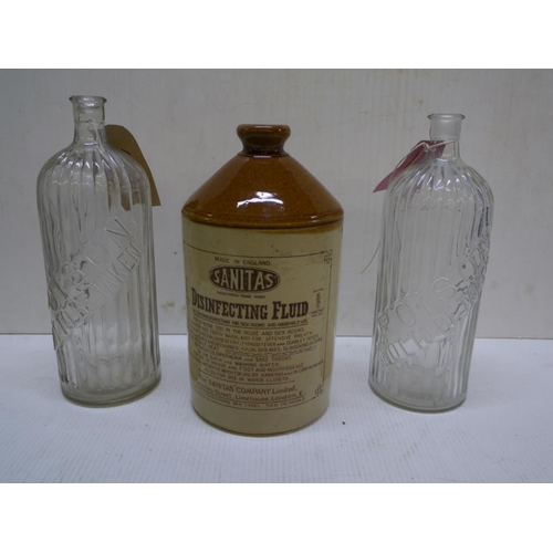 2 - Two large glass chemist bottles marked poison not to be taken and a Sanitas stoneware disinfecting f...