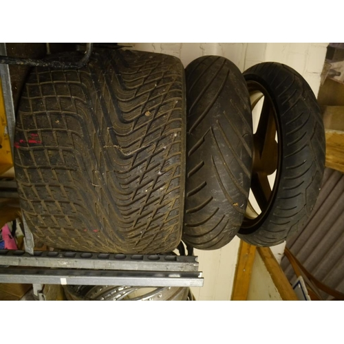 19 - 3 Wheels and tyres to include one 1960's formula 1 tyre...
