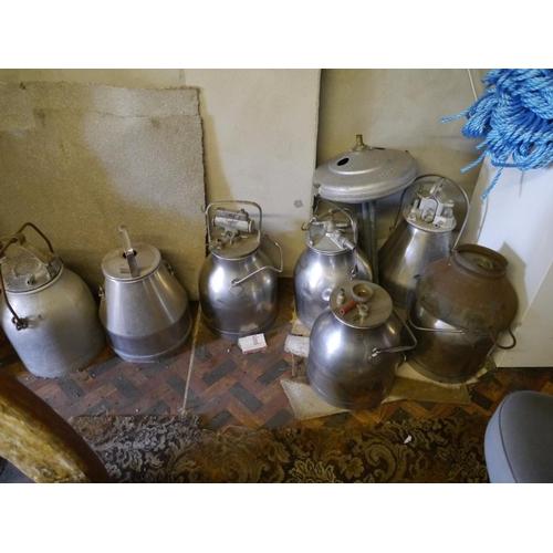 10 - Stainless steel milk buckets...