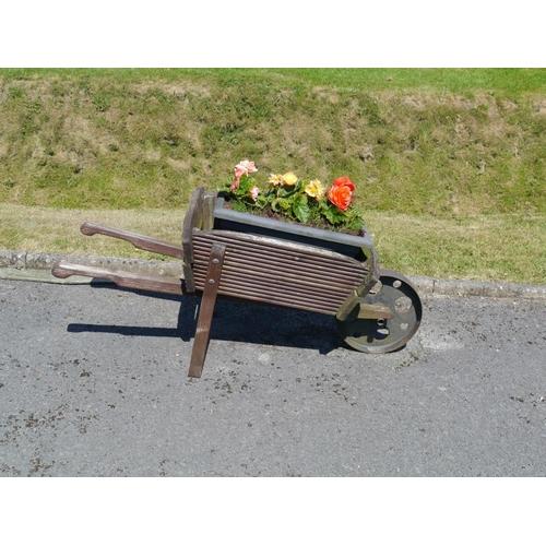 3 - Small wooden wheelbarrow...