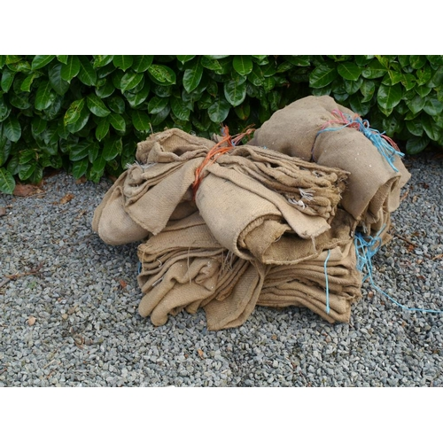 7 - 4 Bundles of hessian sacks...