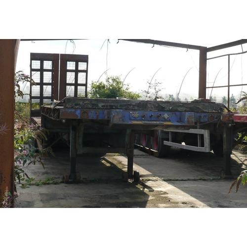 9 - Cooks tri axle low load trailer. swan neck, beaver tail, hydraulic ramps, outriggers, 1980...