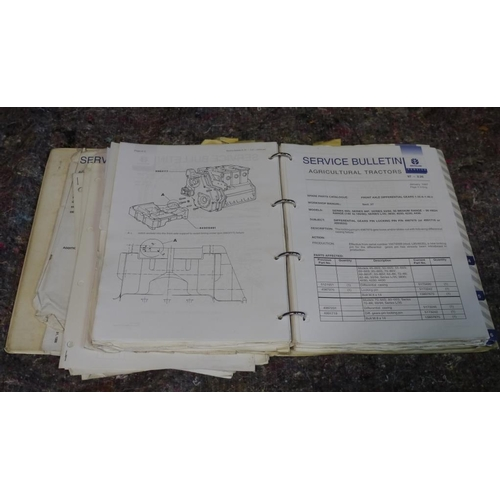 32 - New Holland tractor service bulletins. 90's Era...