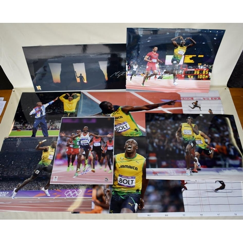 50 - Signed photograph of Michael Johnson, quantity of Usain Bolt and Mo Farah photographs, one signed Mo...