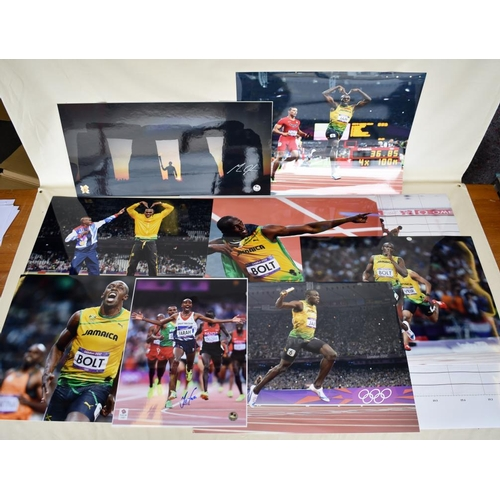 51 - Signed photograph of Michael Johnson, signed Mo Farah photograph, quantity of Usain Bolt and Mo Fara...
