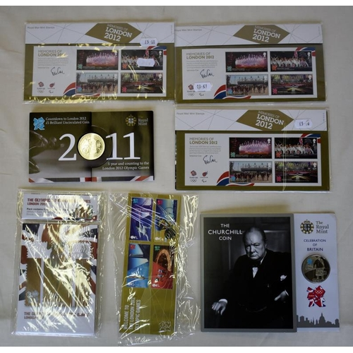56 - Three sets of 2012 Olympics stamps, commemorative £5 London 2012 countdown coin, a commemorative Chu...