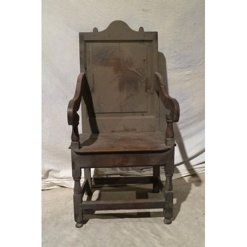 38 - Early oak hall chair with panelled back...