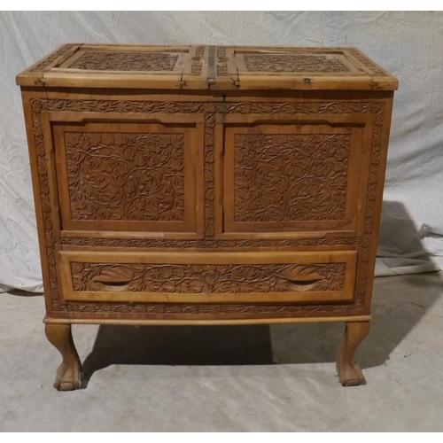 50 - Teak carved drinks cabinet on cabriole legs...