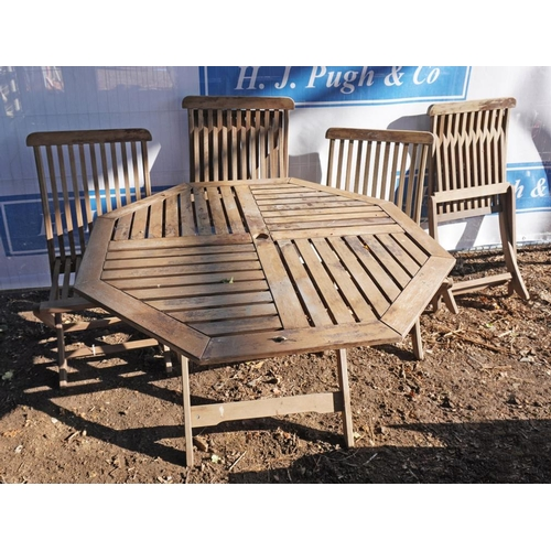 11 - Teak garden table and 4 folding chairs...
