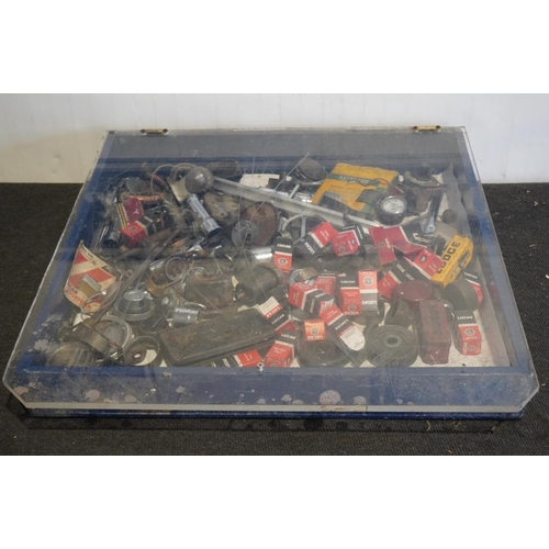 8 - Display cabinet of assorted spares NOS...