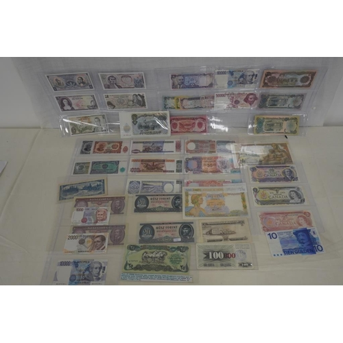 23 - Large quantity of assorted world bank notes in good grades...