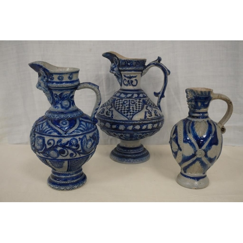 31 - 3 Assorted Westerwald jugs. Blue and white A/F...