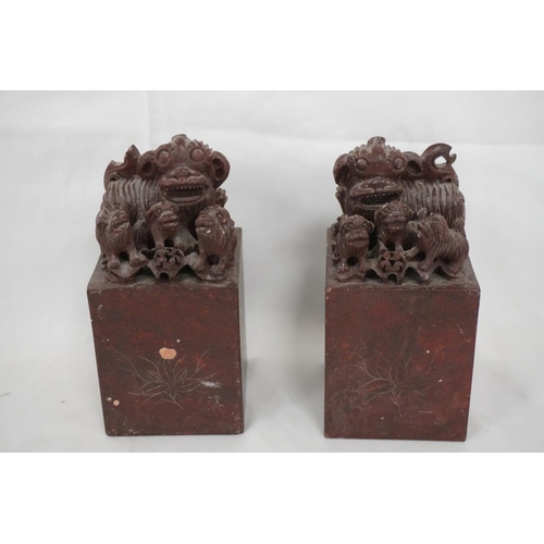 32A - Late 19th/early 20thC Chinese carved roseate soapstone scroll weights/book ends...