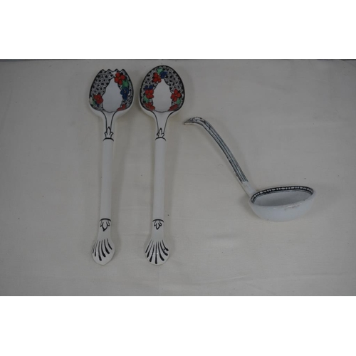 38 - Pair of salad servers, black & white with floral pattern and china soup ladle...