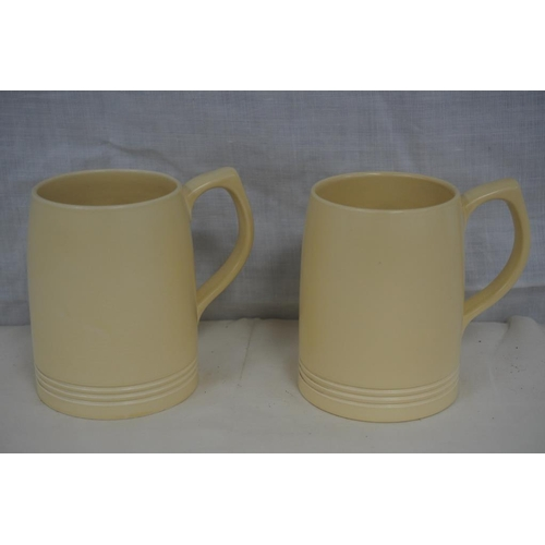 52 - Pair of Keith Murray for Wedgwood harvest yellow tankards...