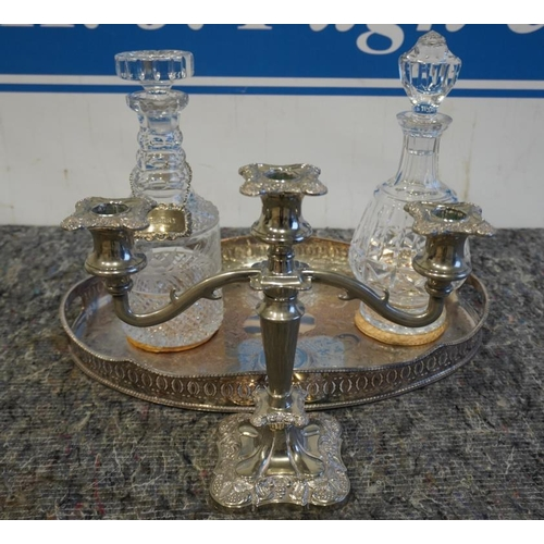22 - Cut glass decanters with silver label, plated candle holder and tray...