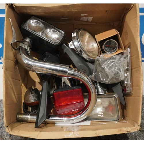 14 - Exhausts, headlamps and speedometer...