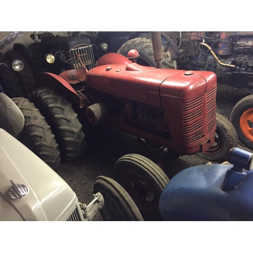 1556 - International W4 tractor. In good condition...