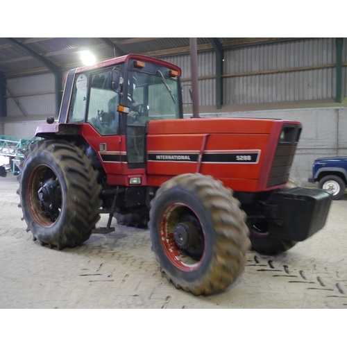 1563 - International 5288 tractor. 4WD. c/w front weights and dual rear wheels, pick up hitch, off farm con...