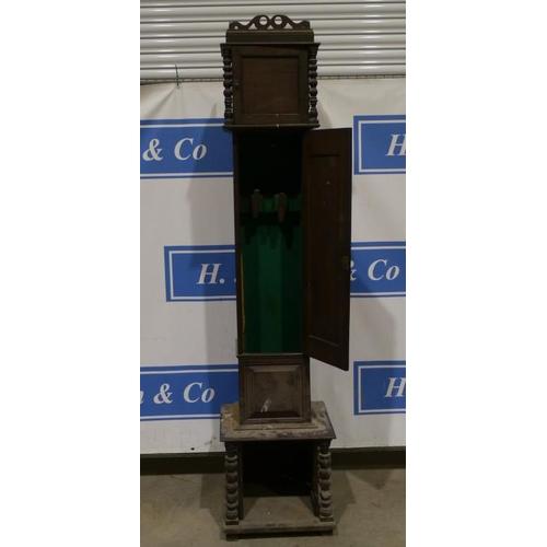 14 - Oak gun cabinet in the style of a long case clock...