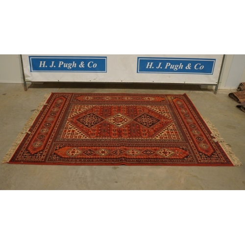 42 - Red patterned rug 93x67