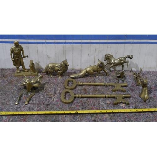 45 - Brass ornaments and brass door knockers...
