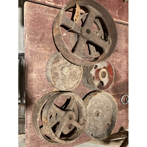 10 - 7 Various cast iron wheels and fly wheels...