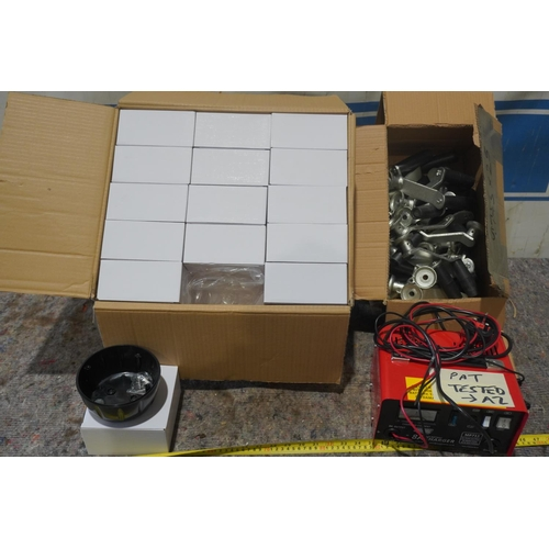 14 - Box of jockey wheel handles, battery charger and box of plastc bases +VAT