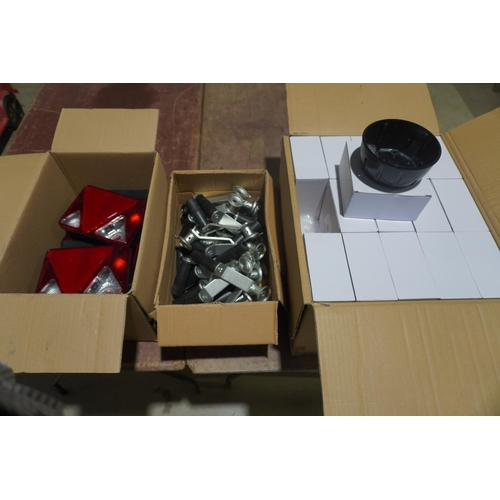 16 - Box of trailer lights, box of jockey wheel handles and box of plastic bases +VAT