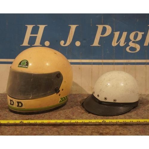22 - 2 Vintage motorcycle helmets