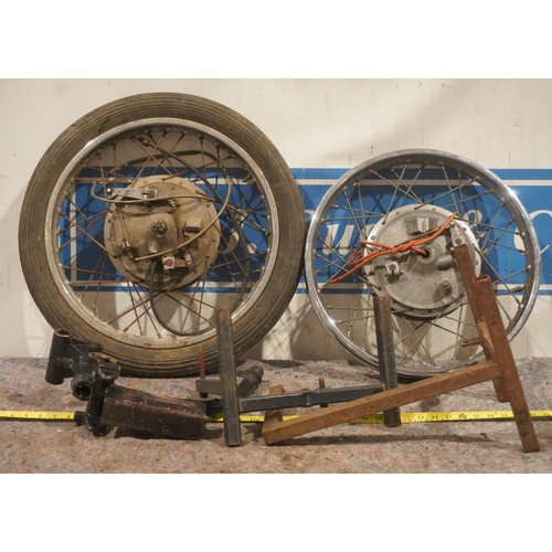 33 - Motorcycle front wheels and stands