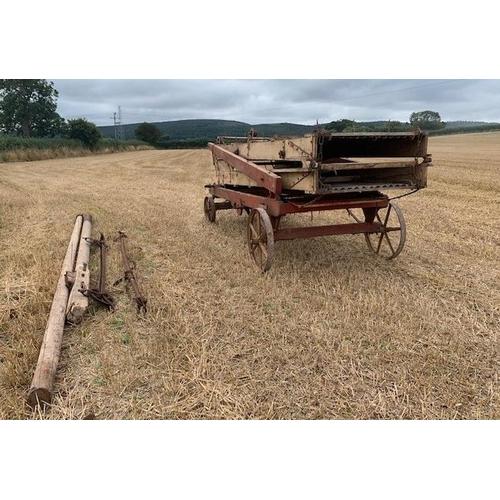 65 - Hay loader on iron wheels. Wallis Titt & Co