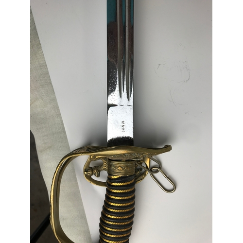 33 - Pair of decorative swords, with brass hinged hand gaurds. one stamped W & Co, the other Soligen A & ...