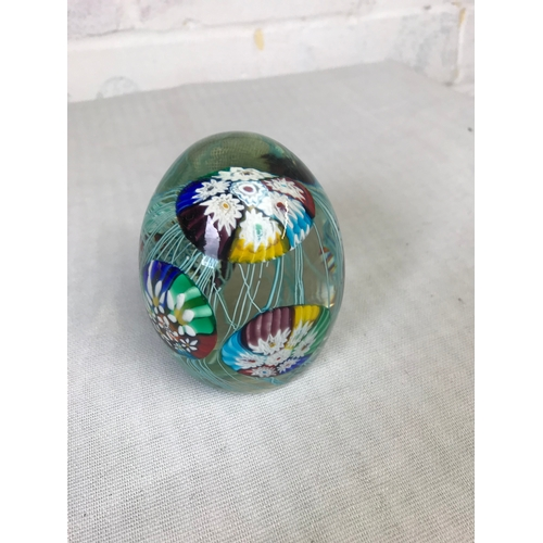 57 - A glass dumpy with milifiori styalised jellyfish....