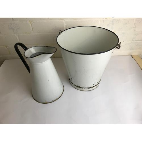 35 - Enamel bucket and water jug....