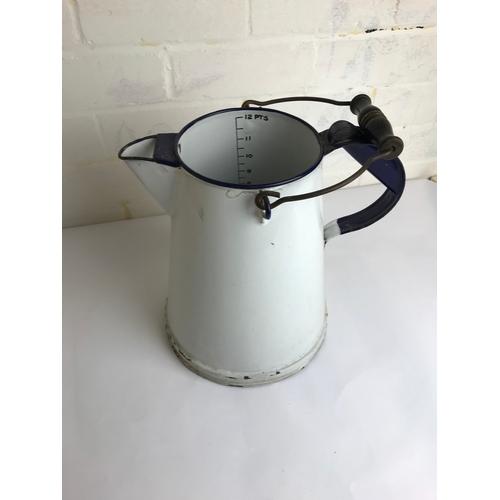 36 - Enamel milk measuring jug....