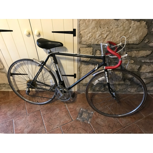 37 - Raliegh Pursuit, road bike, 18-23. with spare racing mud gaurds....