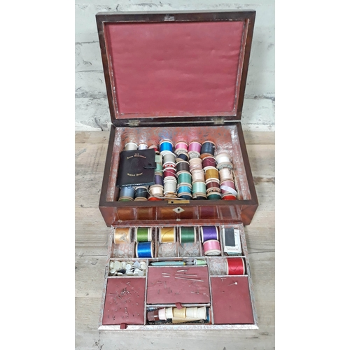 290 - A Victorian Rosewood sewing box and contents....