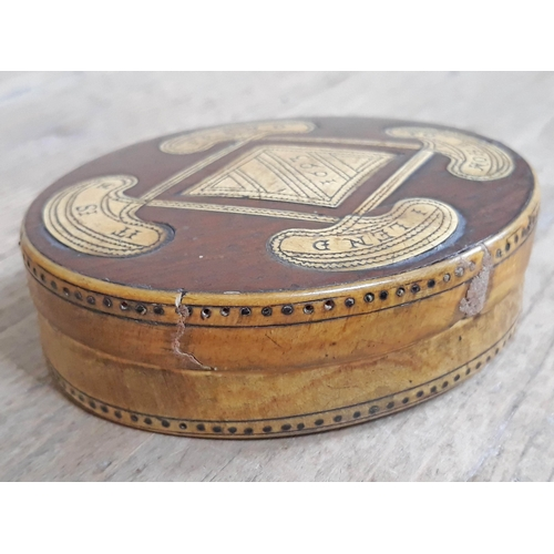 291 - A 17th Century horn and wood snuff box of oval form with verse to top 'It Is A Frend To Whom I Lend'...