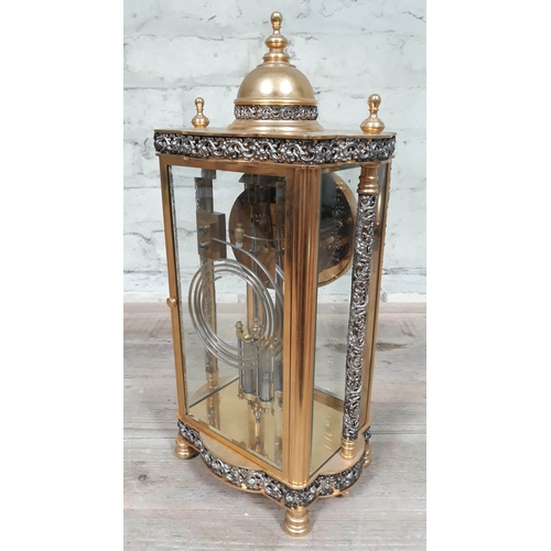 56 - A French four glass brass mantel clock with pierced folliate bands and pillars, the movement strikin...