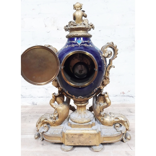 59 - A French 19th Century gilt metal and porcelain mantle clock by Aubert & Klaftenberger, Geneve, blue ...