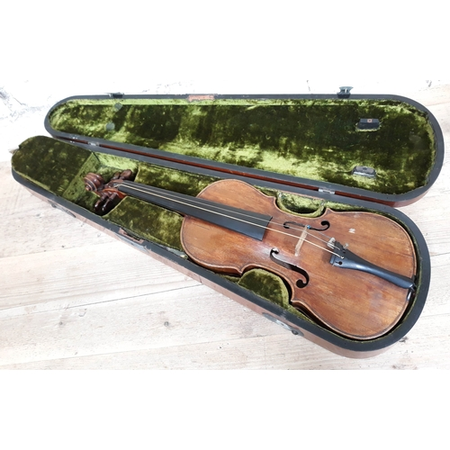 84 - A 19th Century violin, probably Italian, length of back 36cm, with hard case and interesting receipt...